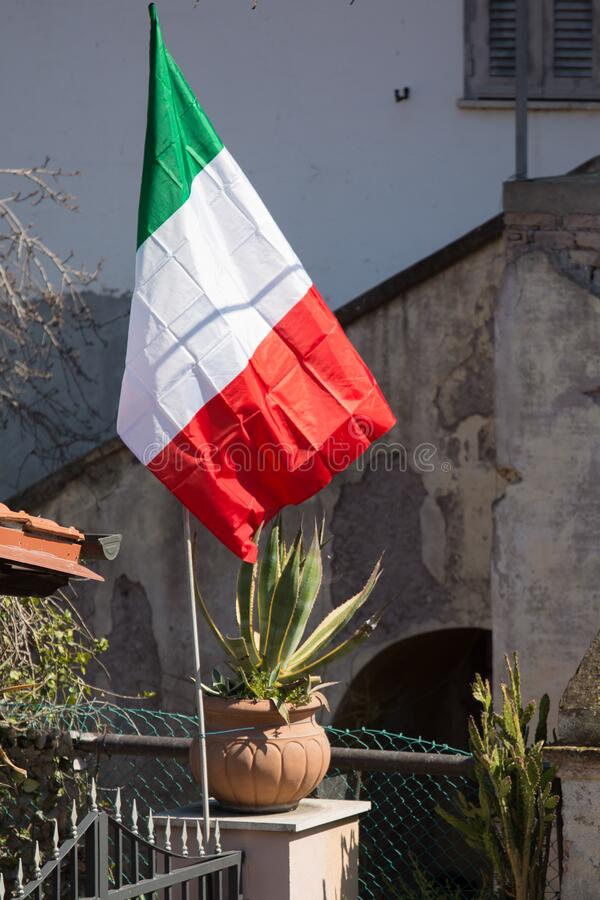 Italian Flag. An Italian flag raised up for solidarity during the Covid19  pandemic royalty free stock photo