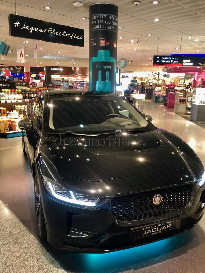 The new Jaguar I-Pace electric car on display for visitors of the duty free shops of Frankfurt Airport to win. stock photography
