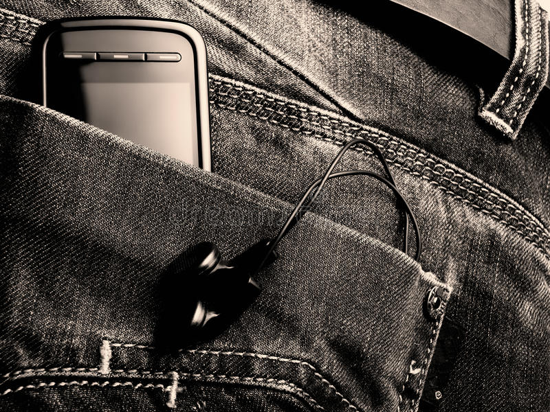 New jeans generation. Metaphor about new jeans generation with digital equipment. Toned BW image royalty free stock images