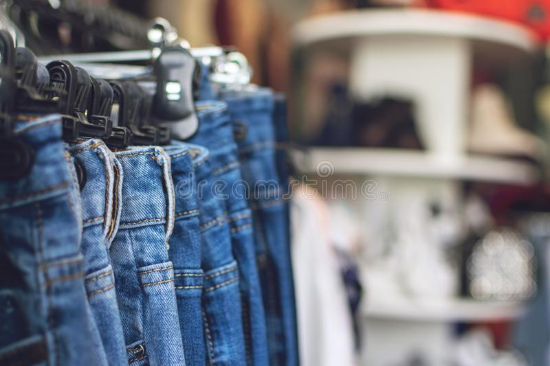 New jeans in retail shop, store. Fall winter fashion trends. Fashion shopping sale background with copy space stock photo