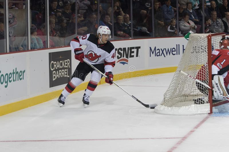 New Jersey Devil Blake Coleman. Blake Coleman skates behind his hockey net during an National Hockey League game. The NHL had the New Jersey Devils against the stock images