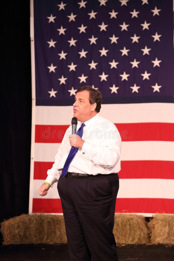 New Jersey Governor Chris Christie speaks in front of US flag royalty free stock photo