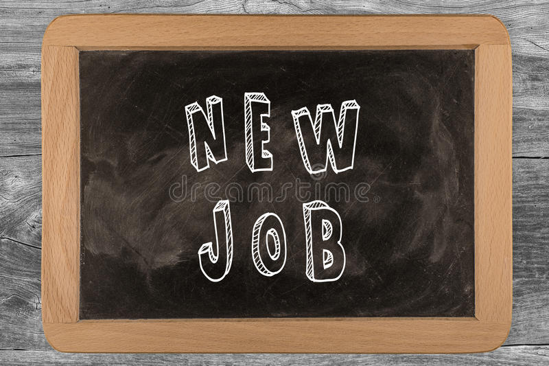 New job - chalkboard with 3D outlined text - on wood stock image