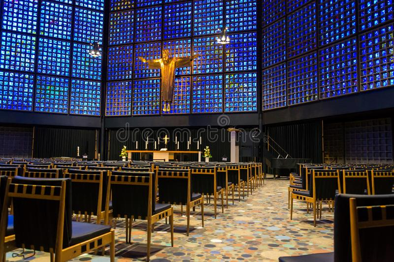 New Kaiser Wilhelm Memorial Church interior with crucifix and stained glass inlays, Berlin. Germany stock images