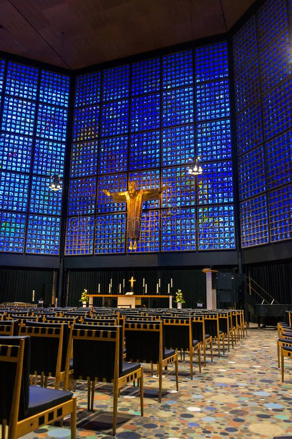 New Kaiser Wilhelm Memorial Church interior with crucifix and stained glass inlays, Berlin. Germany royalty free stock photography