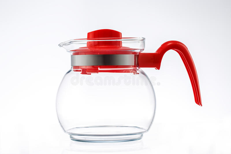 New kettle or jug isolated on white. New glass kettle or jug isolated on white background stock images