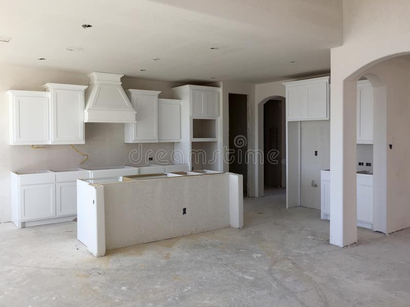 A new kitchen with island counter under construction stock image
