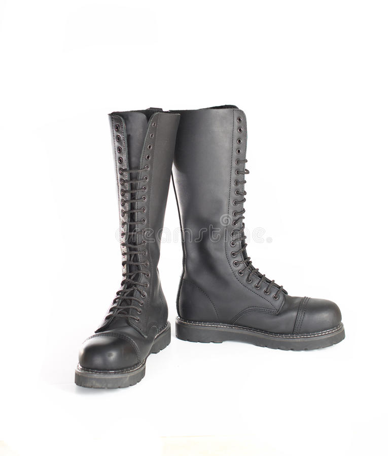 New knee high lace up black combat boots. New tall lace-up knee-high black leather boots featuring 20 eyelets and steel-toes. Fashion combat work boots worn by royalty free stock photography