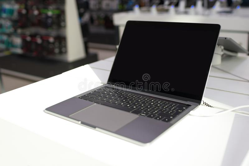 New lap top exposed on white table in electronic store royalty free stock photography