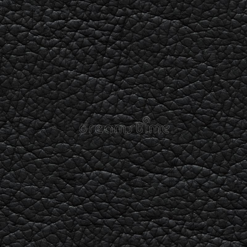 New leather background in strict dark colour. Seamless square texture. royalty free stock photos