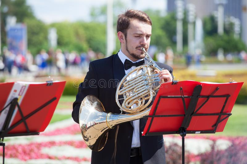 New Life Brass band classical quintet of brass wind musical instruments, orchestra performs music, man musician plays French horn stock photo