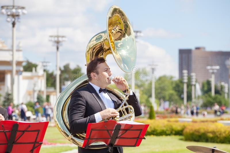 New Life Brass band, wind musical instrument player, orchestra performs music, man musician plays big sousaphone, trumpeter royalty free stock photos