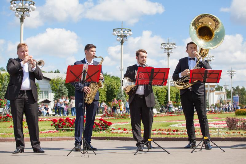 New Life Brass band, wind musical instrument players, orchestra performs music, four men musicians play trumpets royalty free stock photo