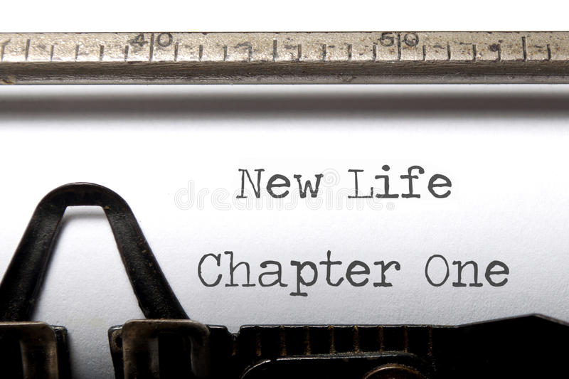 New life. Chapter printed on a vintage typewriter royalty free stock photo
