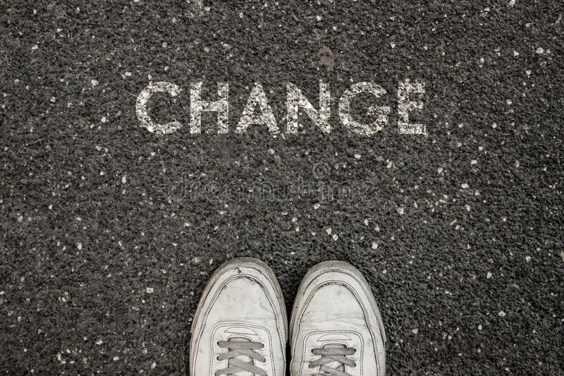 New Life Concept, Motivational Slogan with Word CHANGE on the ground of asphalt royalty free stock image