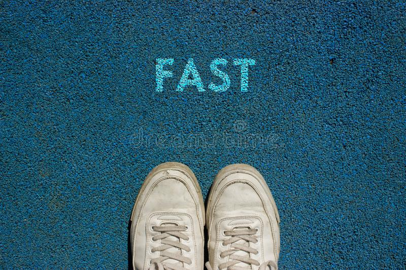 New Life Concept, Motivational Slogan with Word FAST on the ground of walk way stock image