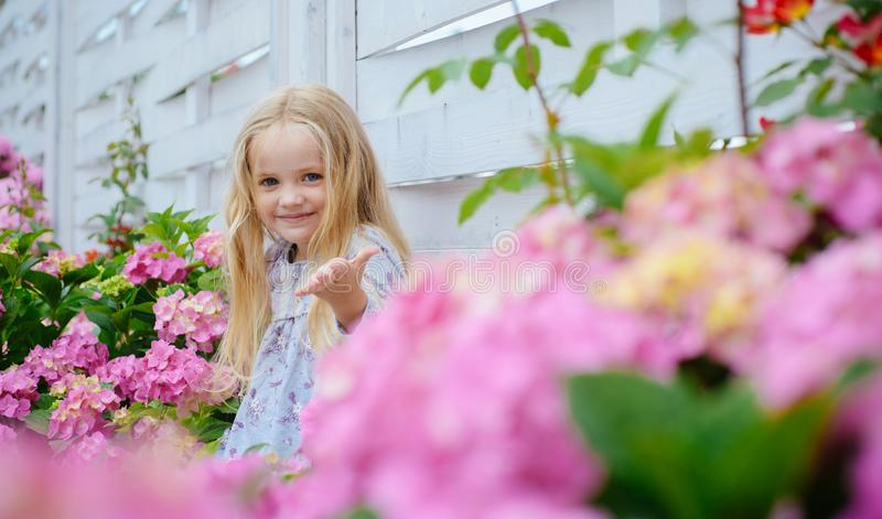 New life concept. Spring holiday. Summer. Mothers or womens day. Childrens day. Small baby girl. Little girl at blooming stock photography