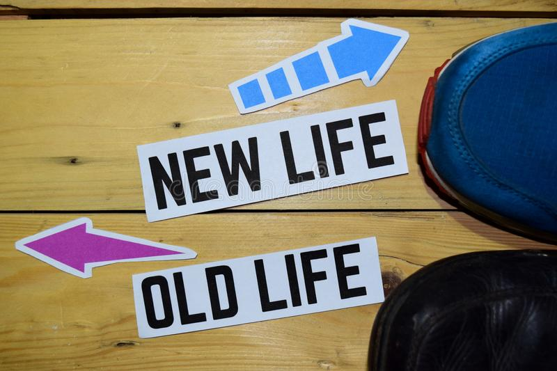 New Life or Old Life opposite direction signs with sneakers on wooden. Vintage background. Business and education concepts royalty free stock photos