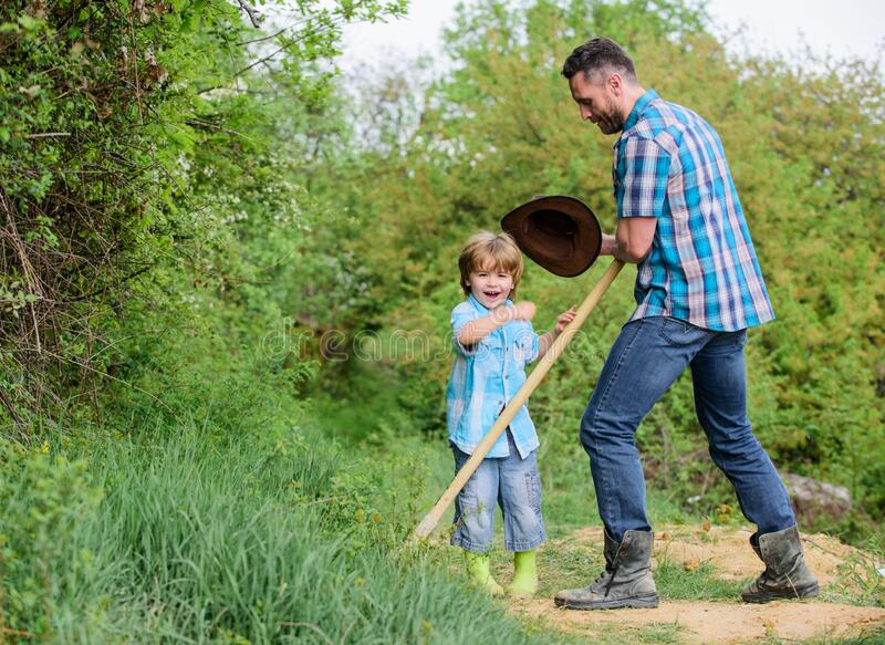 New life. soils and fertilizers. father and son planting family tree. rich natural soil. Eco farm. Ranch. happy earth royalty free stock photography