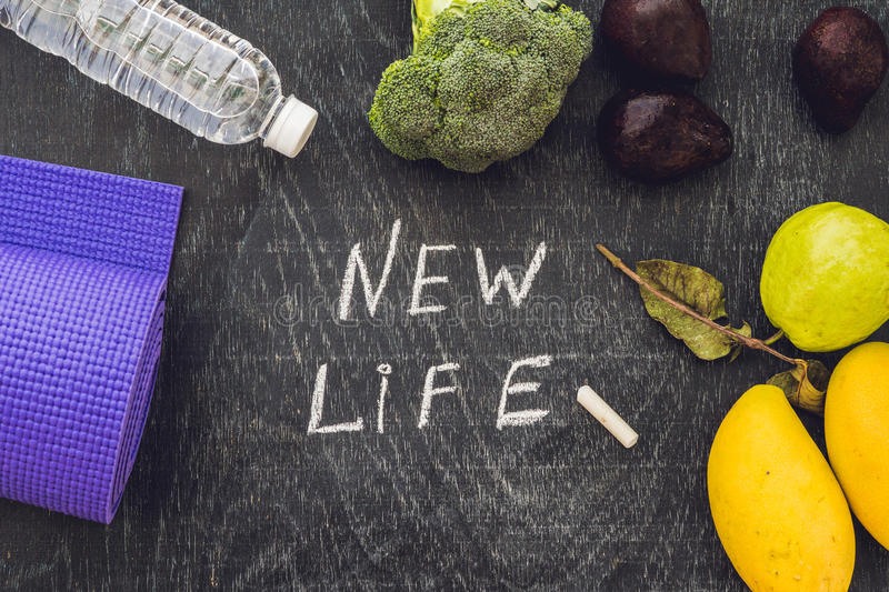 New life is written on chalk board. New life concept stock photos