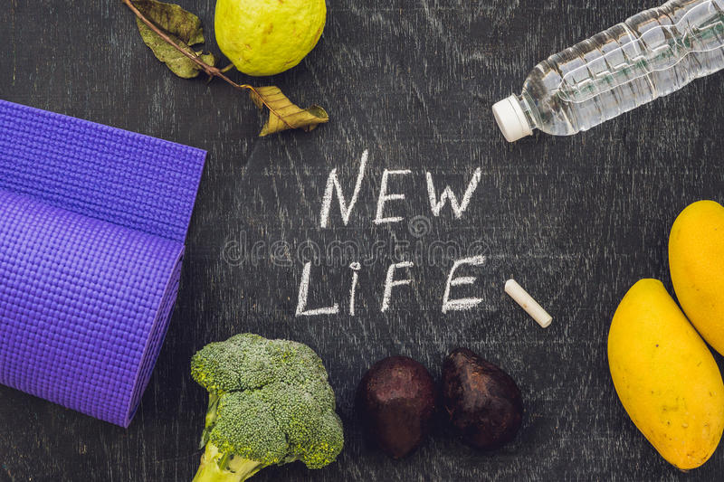 New life is written on chalk board. New life concept stock photo