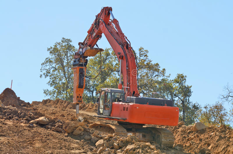 New Lift. Construction bulldozer pushing out a new lift of dirt and rock for a new road on a commercial development project stock photography