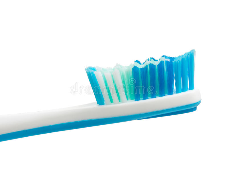 New light-blue toothbrush. Light-blue toothbrush isolated on white background stock photography