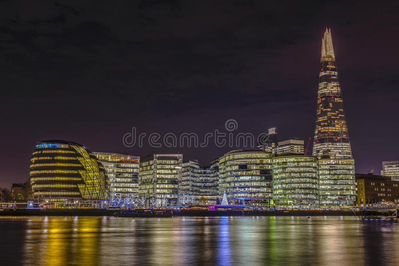 New London city hall at night. Panoramic view from river royalty free stock photo
