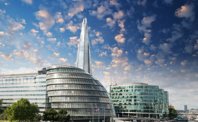 New London city hall with Thames river and cloudy sky, panoramic. View from Tower Bridge - UK royalty free stock photography