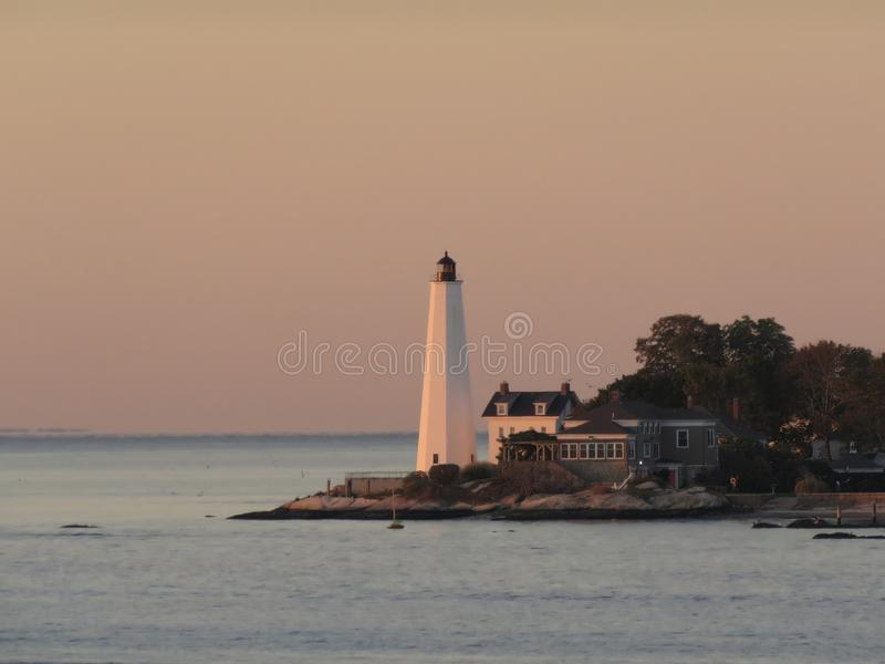 Early morning light at New London Harbor Lighthouse stock image