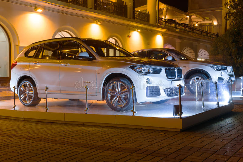 New Luxury Bmw x4 and x6 at night, new model of the brand BMW near the dealers showroom. Sochi, Russia - October 12, 2016: New Luxury Bmw x4 and x6 at night stock images
