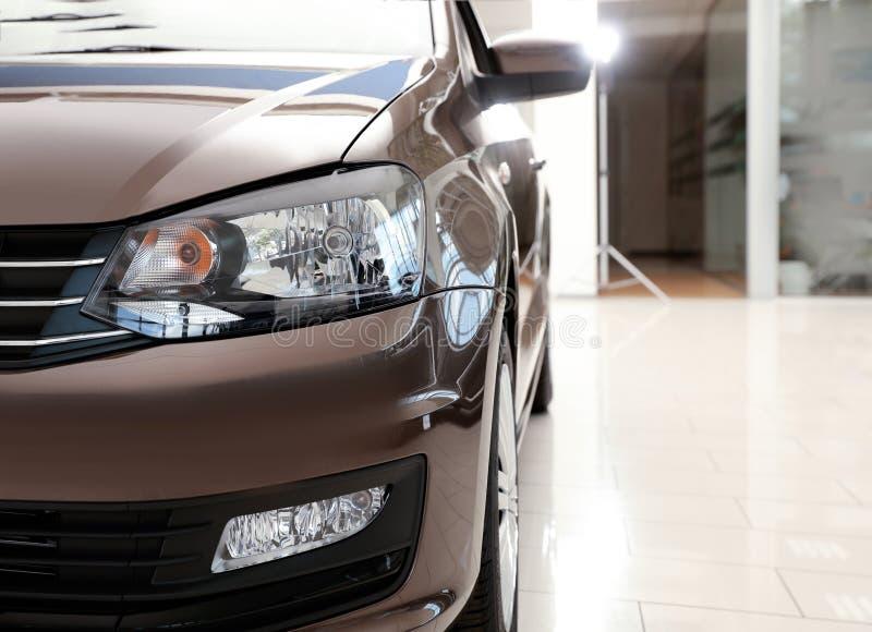 New luxury car in modern auto dealership. Closeup stock photo