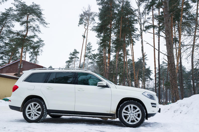 Download New Luxury Crossover Mercedes Parked In Winter Forest. Editorial Photo - Image: 83721736