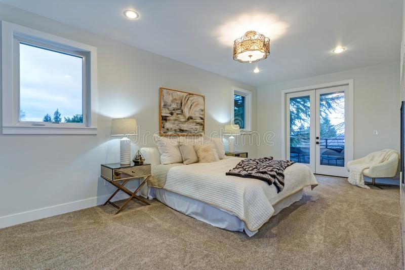 New luxury custom built home with white master bedroom. stock images