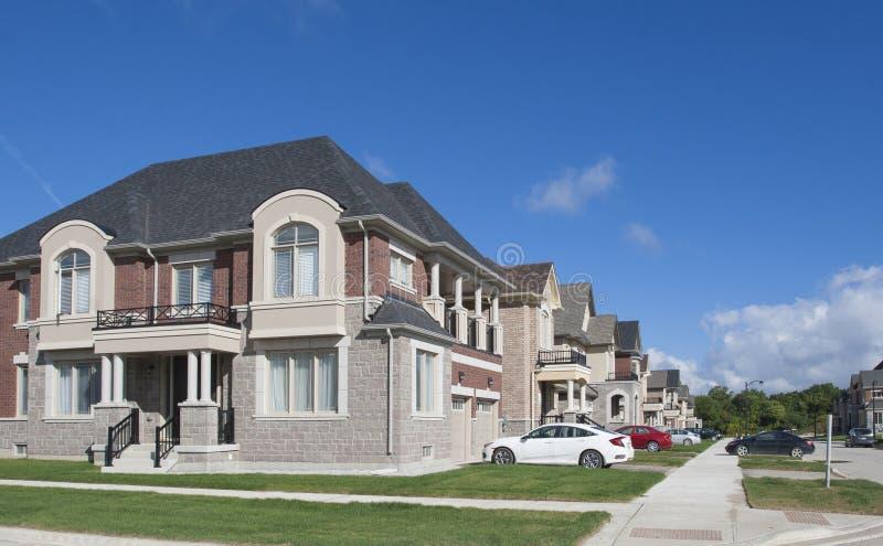 New luxury houses in great Toronto area,Ontario,Canada. New luxury houses with green lawn in great Toronto area, Ontario, Canada royalty free stock photo