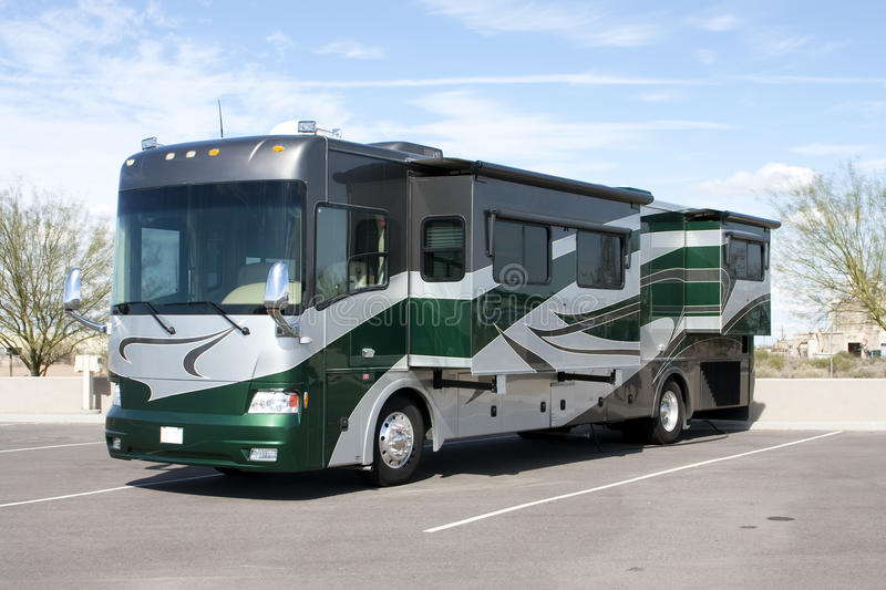 New Luxury Motor Home RV Coach. Brand new luxury RV motor home coach outdoors in parking lot stock photography