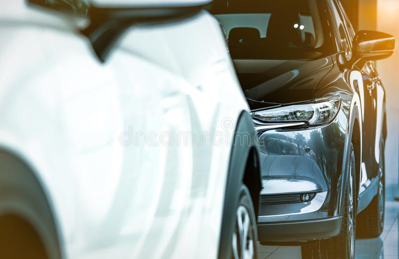 New luxury shiny SUV compact car parked in modern showroom. Car dealership office. Car retail shop. Electric car technology. And business concept. Automobile royalty free stock image