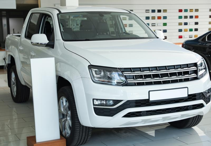 New luxury white car in auto dealership. New luxury white car in modern auto dealership stock images