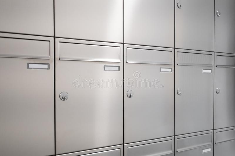 New mailboxes. Many new mailboxes / postbox / letterbox royalty free stock photo