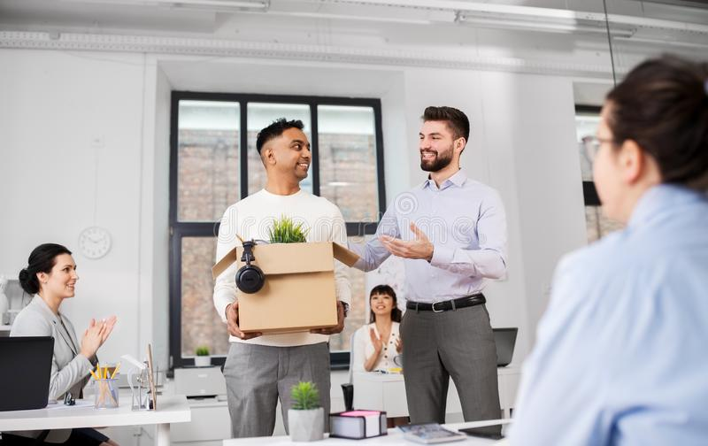 New male employee meeting colleagues at office stock photo