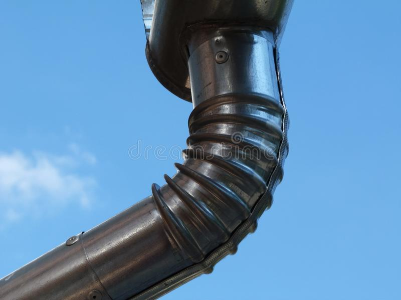New metal rain water leader and downspout, eavestrough stock image