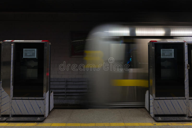 The new metro train running underground in Delhi, India. Motion blur, long exposure, passenger viewpoint from station. royalty free stock photos