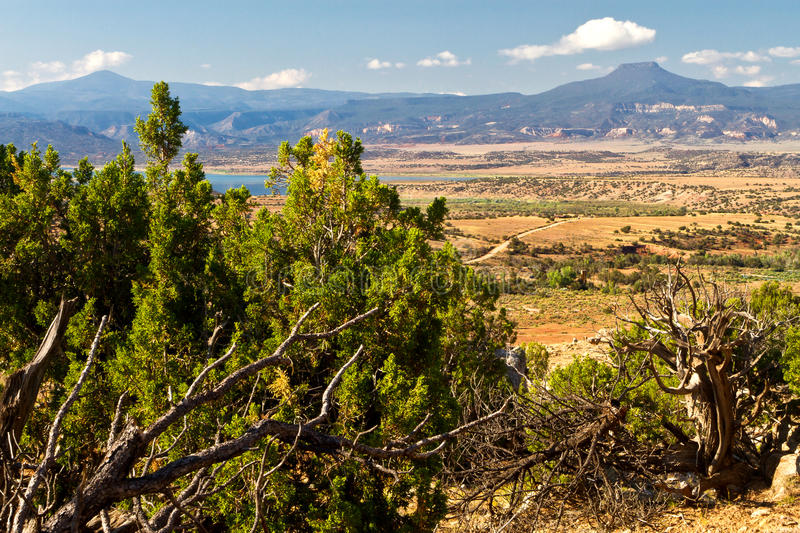 New Mexico desert landscape. Near Ghost Ranch showing Abiquiu Lake and Pedernal mountain stock image