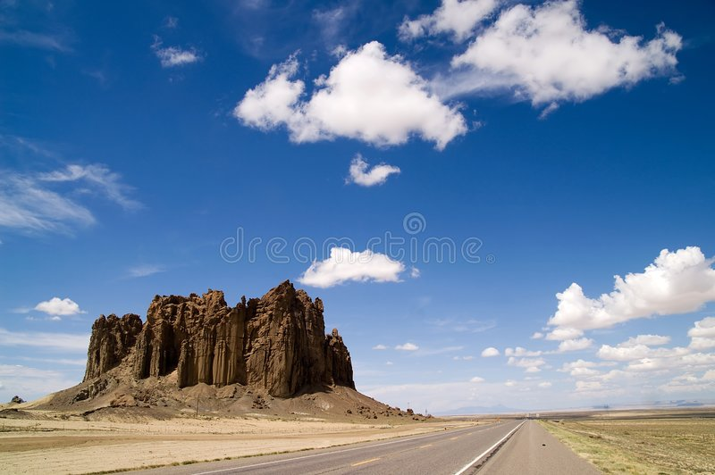 New Mexico Highway 666. Beautiful clouds- and landscape with rock formation in New Mexico, USA royalty free stock photography