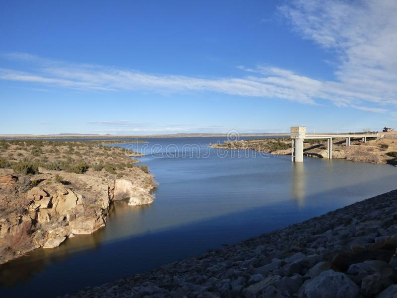 New Mexico Lake and Dam. Santa Rosa Lake and Dam in New Mexico as viewed from the top of the man-made dam, holding back the waters of the Pecos River for use in stock image