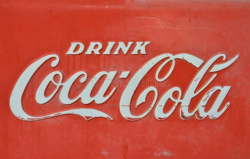 Sign Of Coca Cola Painted In A Rusty And Old Metal Editorial