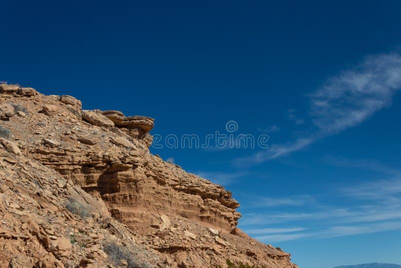 New Mexico USA rocky outcrop in desert mountain area, brilliant blue sky. Horizontal aspect stock image