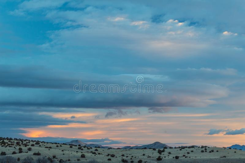 New Mexico winter morning, sunrise with blue skies, distant mountains. Horizontal aspect royalty free stock photography