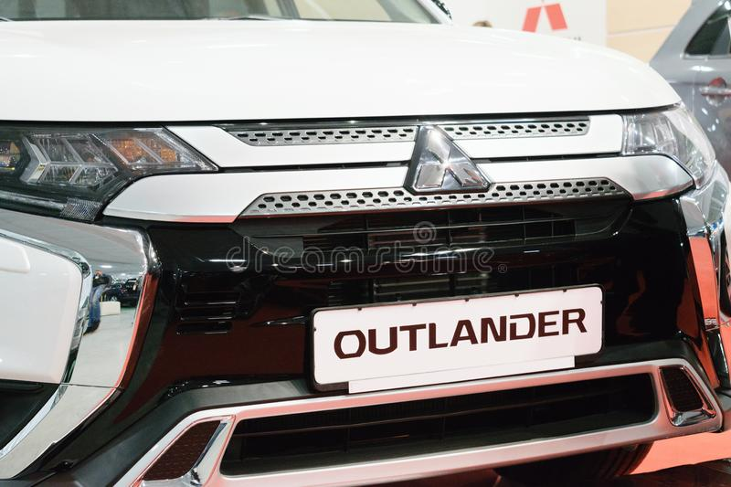 New Mitsubishi Outlander. Sport compact car shown at the Motor Show. White Outlander Eclipse, compact crossover produced by Mitsubishi Motors royalty free stock image