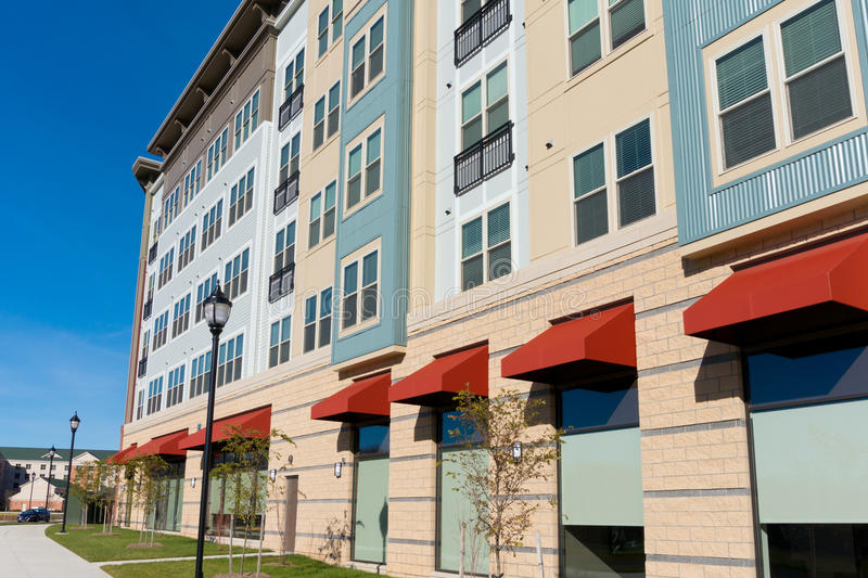 New mixed use building exterior. With retail, office and residential space stock images